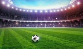 Stade de football illuminé pour le championnat Photos stock