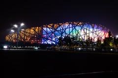 Stade du nid de l'oiseau dans le village olympique de Pékin Photos stock