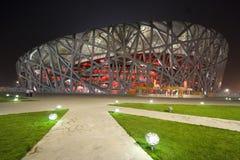 Stade olympique de Pékin la nuit Photos libres de droits