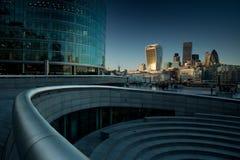 Staden av London på solnedgången Arkivfoto