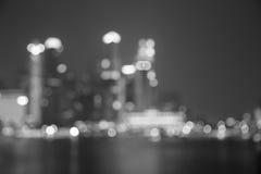 Staden tänder svartvit suddig bakgrund för bokeh Arkivbilder