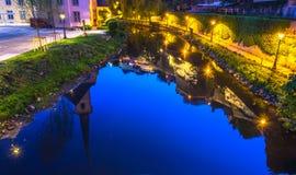 Staden under vatten, reflexion av staden Arkivfoton