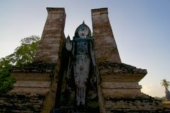 Stading white Buddha statue in the Sukhothai Historical Park stock photo