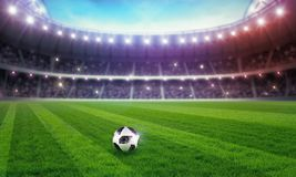 Stadio di calcio illuminato per il campionato Fotografie Stock