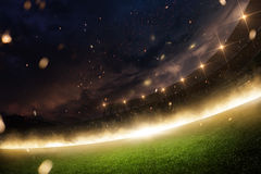 Stadion i brand, rök och natt Royaltyfria Bilder