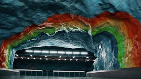 Stadion metro station of Stockholm, Sweden. Rainbow style rocks and beautiful modern transport interior stock video