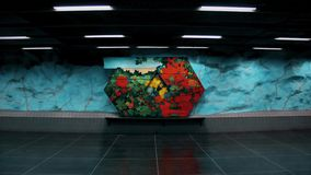 Stadion metro station of Stockholm, Sweden. Tunnel. Of stadion is cyan walls and colorful flower paintings stock video footage