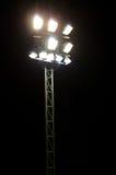 Stadionlampor på ett sportfält Fotografering för Bildbyråer