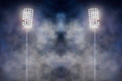 Stadionlichten en rook stock fotografie