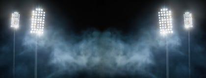 Stadionlichten en rook tegen donkere nachthemel royalty-vrije stock afbeelding