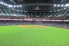 Stadionljus på en basebollarena Royaltyfria Bilder