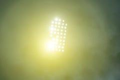 Stadionslichter und -rauch Stockbild