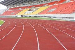 Stadionställning och rinnande spår Royaltyfri Bild