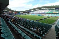 Stadium. Football stadium, empty field, many fans, no advertisement Royalty Free Stock Image