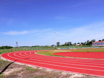Stadium. Racing track at the stadium with a football filed on the Polish country Royalty Free Stock Photos