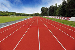 Stadium arena with football field and racing tracks Royalty Free Stock Images