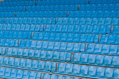 Stadium/Arena seats. Row after row of blue stadium seats. Closeup Royalty Free Stock Images