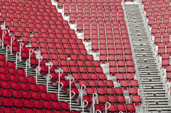 Stadium benches. Empty red seats at the sports stadium Stock Photo