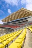 Stadium bleachers. Close up of the modern stadium with blue sky royalty free stock photo