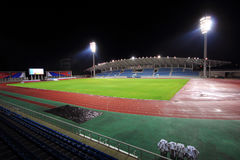 Stadium with bleachers in the night. Stadium at night with bleachers and a soccer field Royalty Free Stock Photo