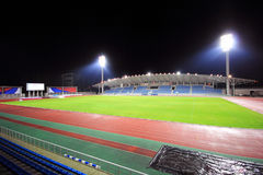 Stadium with bleachers in the night. Stadium at night with bleachers and a soccer field Stock Image