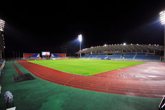 Stadium with bleachers in the night. Stadium at night with bleachers and a soccer field Royalty Free Stock Photography