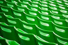 Stadium chairs backs. Background from stadium green chairs backs stock photography