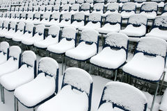 Stadium chairs covered in snow Stock Photo