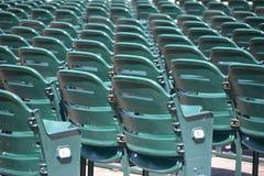 Stadium chairs. Empty green stadium chairs on sunny day stock photos