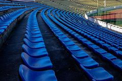 Stadium chairs rows in blue. And white Royalty Free Stock Photos