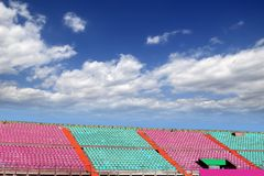 Stadium colorful grandstand blue sky Royalty Free Stock Photo