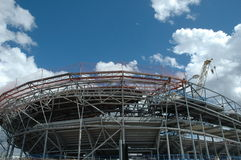 Stadium construction. Construction of a modern arena type stadium with a cantilever roof Royalty Free Stock Images