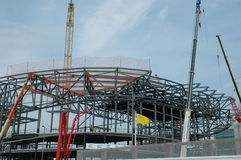 Stadium construction 2. Construction of a modern arena type stadium with a cantilever roof. Here shown with cranes Royalty Free Stock Photography