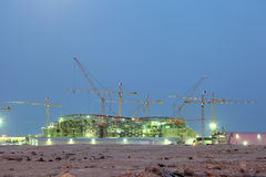 Stadium construction in Qatar. Construction of a new stadium in the desert of Qatar, Middle East Stock Photo