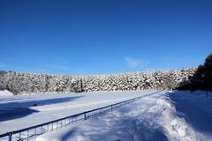 Stadium covered in snow. Winter in Russia. Sunny frosty day.  royalty free stock images