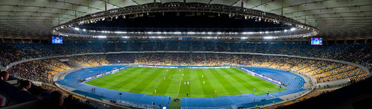 Stadium crowd ultras. Stadium - crowd of fans. The photo has taken during a soccer match: Dynamo Kyiv vs Steaua Bucuresti in the Olympic stadium (NSC Olimpiysky Stock Image