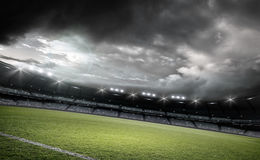 Stadium,3d rendering. The imaginary football stadium is modeled and rendered Royalty Free Stock Photo