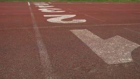 Stadium digits treadmill running start brown rubber sport. Stadium digits treadmill running start brown rubber stock footage
