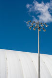 Stadium dome with lights on a sunny day Stock Images