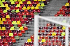 Stadium empty tribune. Detail with empty colored sports arena tribunes on a football stadium Royalty Free Stock Photos