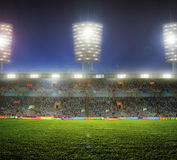 Stadium with fans. The night before the match Royalty Free Stock Image