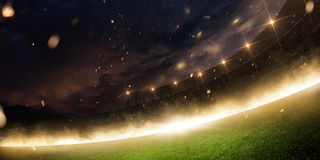 Stadium in fire, smoke and night. Arena stock photography