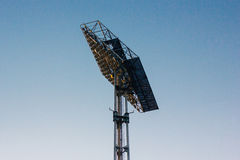 Stadium floodlight reflectors against sky. Royalty Free Stock Photography