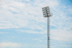 Stadium floodlight tower with blue sky background Stock Images