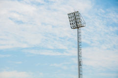 Stadium floodlight tower with blue sky background Royalty Free Stock Image