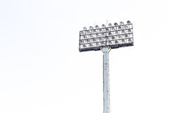 Stadium floodlight on white sky background Royalty Free Stock Photography