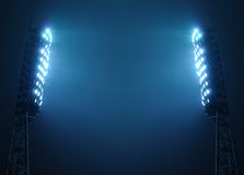 Stadium Floodlights against Dark Night Sky. Stadium floodlights against a dark night sky background with copy space Stock Images