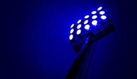 Stadium floodlights. On a sports field at night Royalty Free Stock Photography