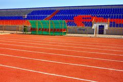STADIUM - Football field with goal and tablo on blue sky Stock Image
