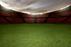 Stadium futbol z zieloną trawą i pustą trybuną zdjęcie royalty free